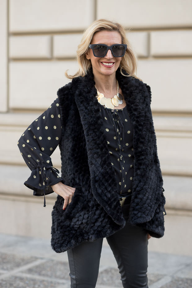 Black and Gold Polkadot Peasant blouse and Faux Fur vest look for the holidays
