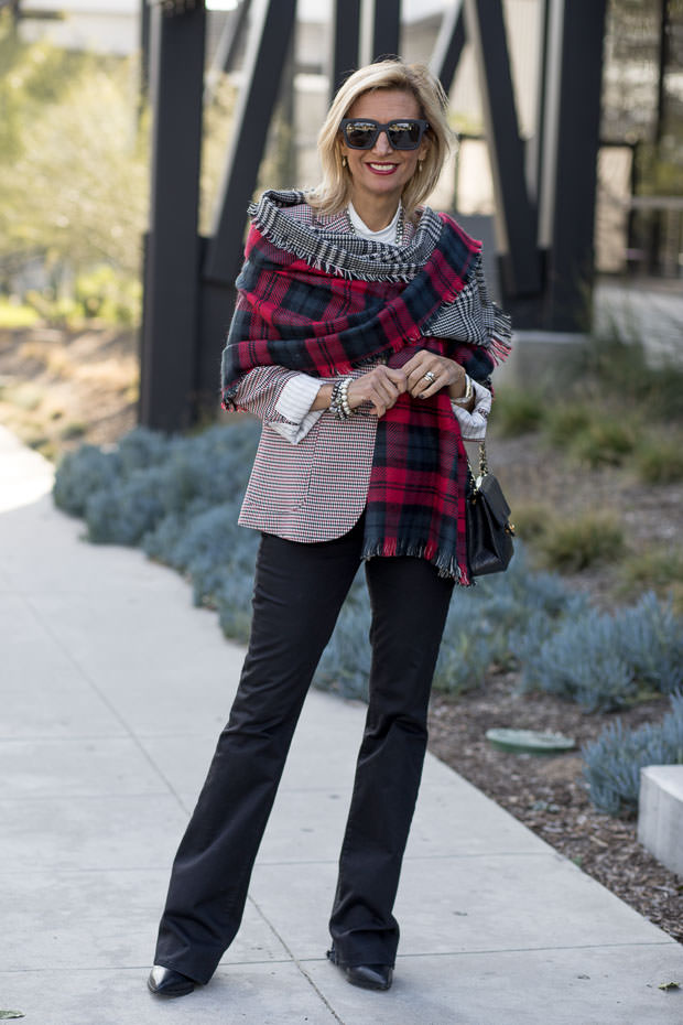 red ivory and black houndstooth blazer for women worn with reversible red black and gray plaid shawl