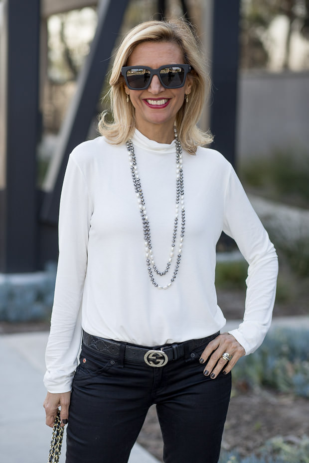 Ivory Mock Neck Top for women worn with black hudson jeans