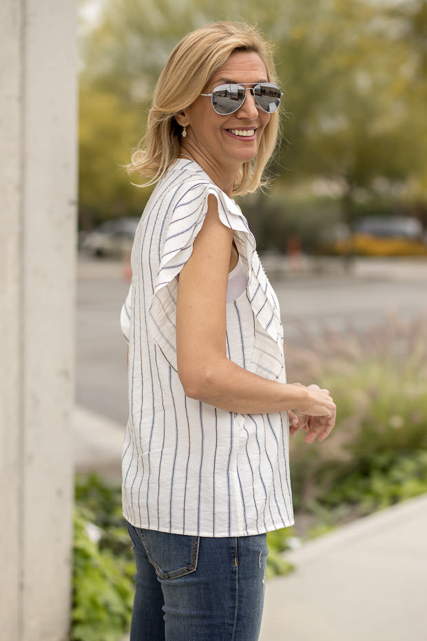 stripe sleeveless shirt with ruffle detail