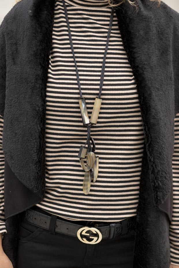 Black Faux Suede Cape Vest with a Taupe and black stripe mock neck
