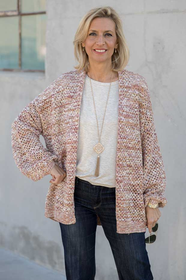 A spring look styled with a multi colored yarn womens cardigan and scarf