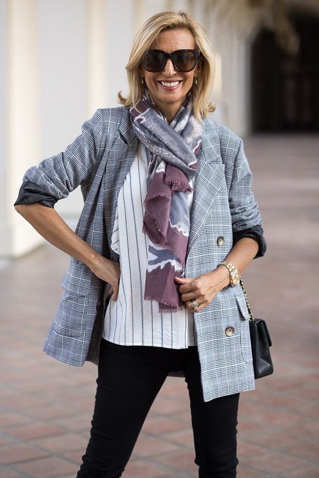 fall trend for women double breasted gray plaid blazer with mauve print scarf closeup