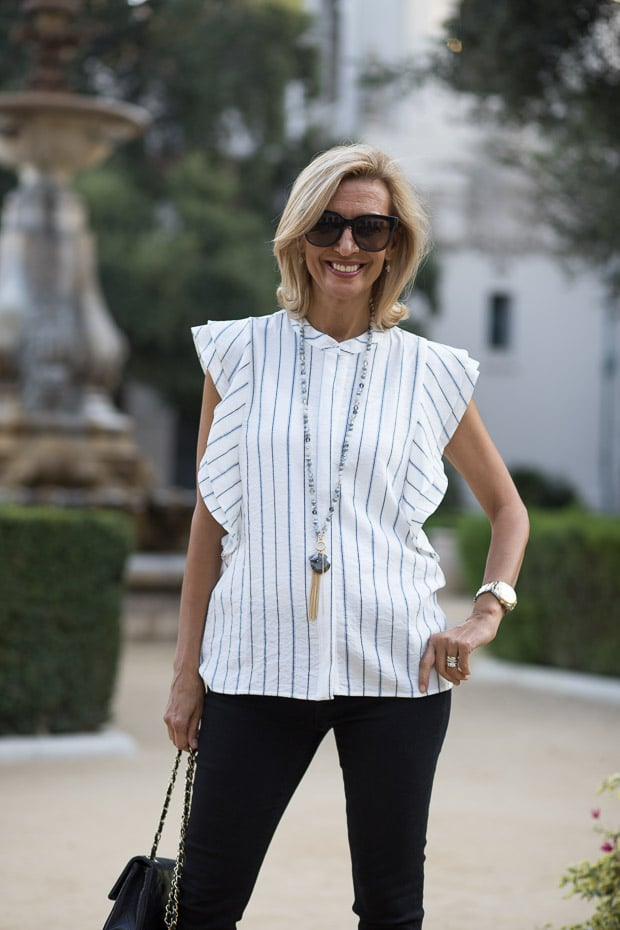 Styling our new stripe sleevless shirt with double ruffle detail and necklace