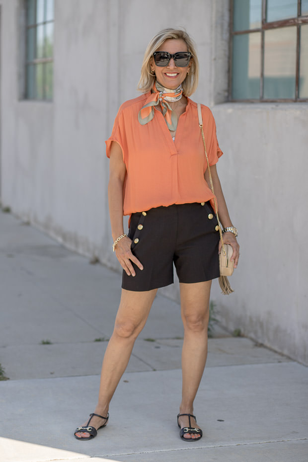 womens orange top with black shorts for a summer look